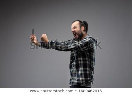 Homem gritando telefone barbudo camisas Foto stock © Giulio_Fornasar
