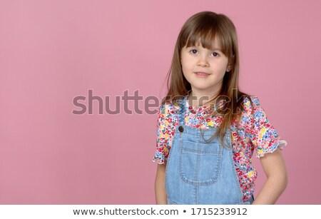 Tatlı küçük kız yıl eski poz kot Stok fotoğraf © dash