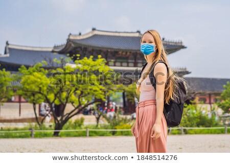 Woman tourist in korea. Gyeongbokgung Palace grounds in Seoul, South Korea. Travel to Korea concept Stock photo © galitskaya