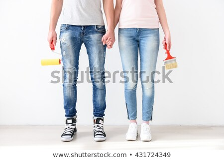 Stock photo: Positive Young Man Holding Brush Roller