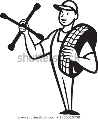 tire mechanic with spanner cartoon Black and White Stock photo © patrimonio