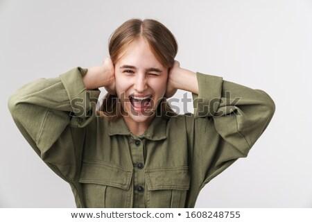 Photo agacé jeune femme hurlant tête isolé Photo stock © deandrobot