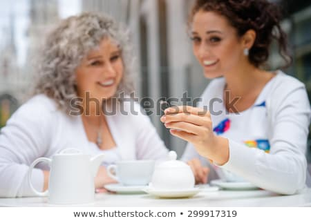 hand of senior woman drinking tea at outdoor cafe Stock photo © dolgachov