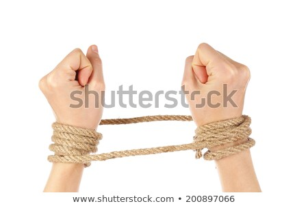 wrists tied with rope stock photo © elenaphoto