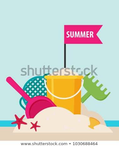 Beach bucket and spades. Stock photo © lovleah