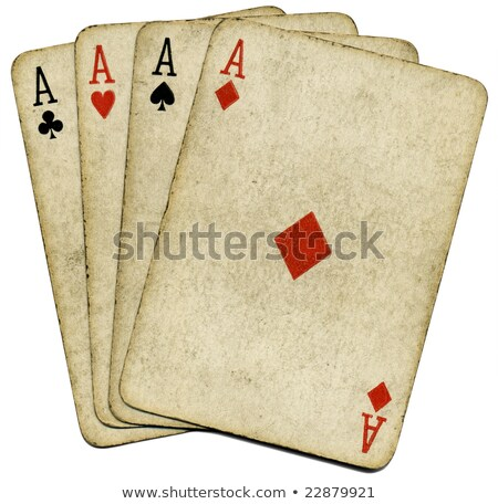 Stock photo: Four Old Vintage Dirty Aces Poker Cards Isolated Over White