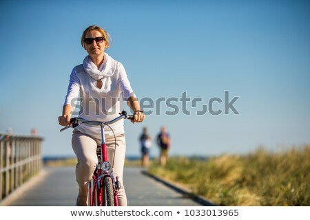 Active woman on a bike Stock photo © photocreo