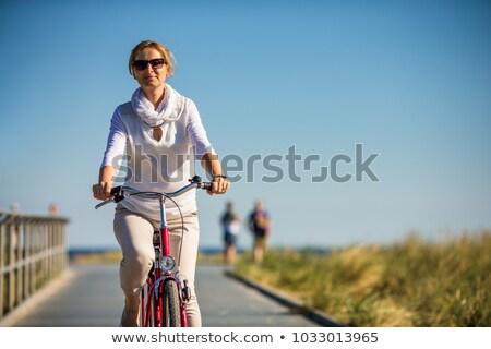 ストックフォト: Active Woman On A Bike