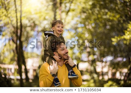 Father with his two sons, one of them on the shoulders stock photo © texelart