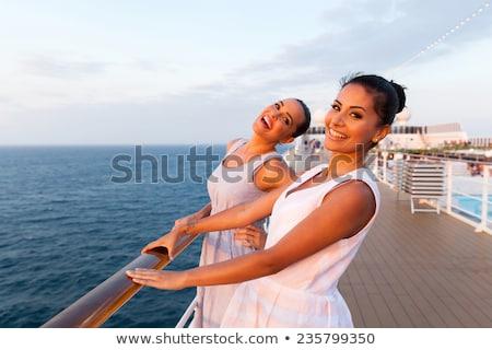 Menina navio de cruzeiro nuvens homem mar verão Foto stock © Galyna