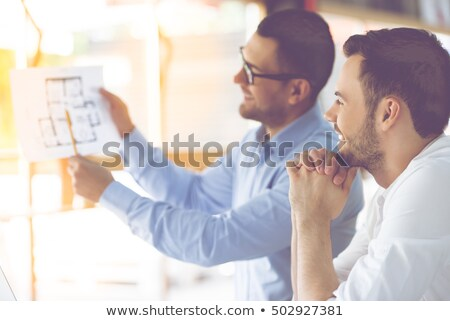 Architect looking at plans Stock photo © photography33