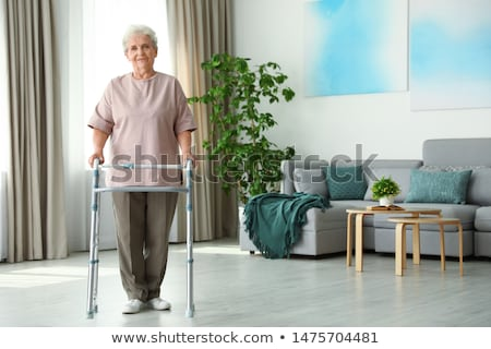 elderly woman using a walking frame in a hospital stock photo © photography33