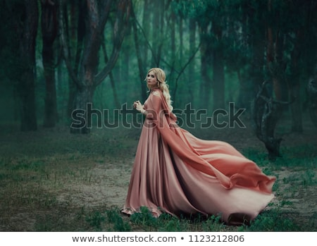 Young woman with blond fluttering hair  Stock photo © dashapetrenko
