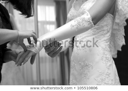 Friend help the bride to wear a glove. Stock photo © m_pavlov