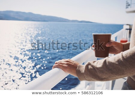 Сток-фото: Young Woman Standing On Sailing Boat With Cup Of Coffee