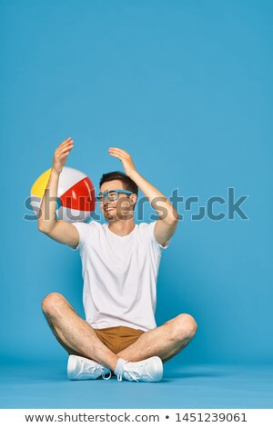Man Holding Beachball Stock photo © piedmontphoto