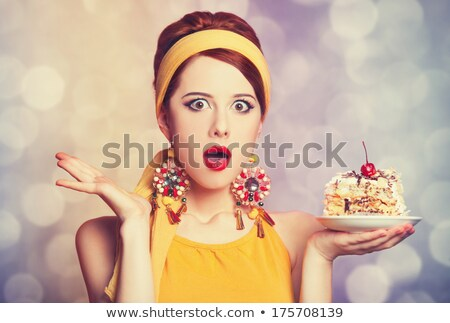 style girl with cake and bokeh at background stock photo © massonforstock