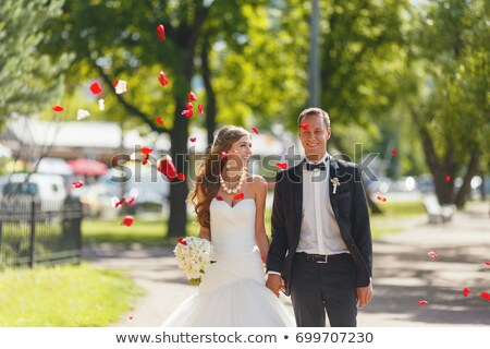 Graceful newlywed in luxurious wedding red dress. Luxury stock photo © gromovataya