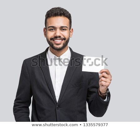 Businessman confidently presenting card Stock photo © photography33