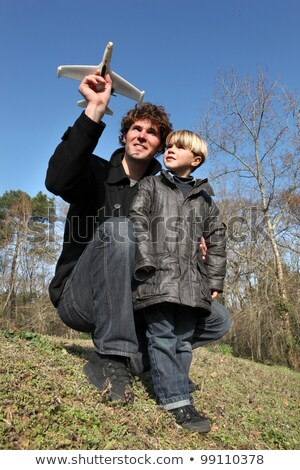 Father showing his son how to launch a toy plane Stock photo © photography33