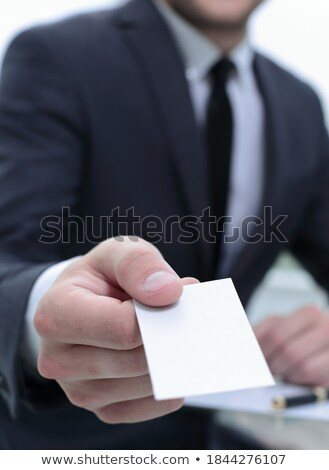 business man offering you his business card  stock photo © ra2studio