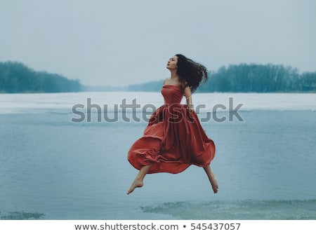 Photo stock: Beautiful Woman In Red Dress On The Shore
