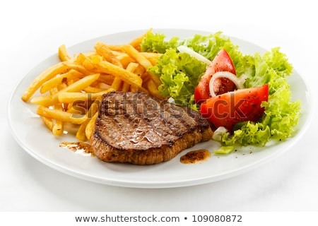 пластина картофель фри бифштекс обеда мяса томатный Сток-фото © M-studio