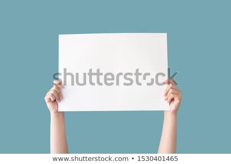 Isolated Happy Woman Holding Sign Stock photo © eldadcarin