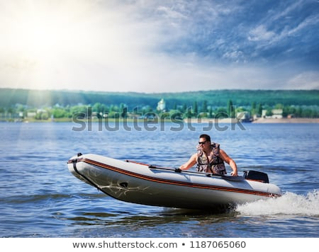 man on inflatable boat with motor Stock photo © Mikko