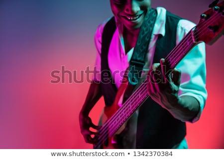 Happy bassist stock photo © danienel