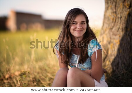 happy woman sitting under the tree closeup face Stock photo © chesterf