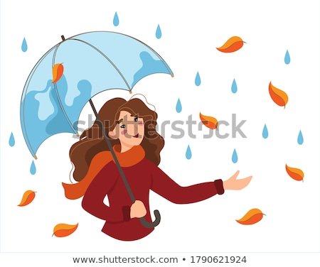 young happy woman walking in the rain stock photo © andersonrise