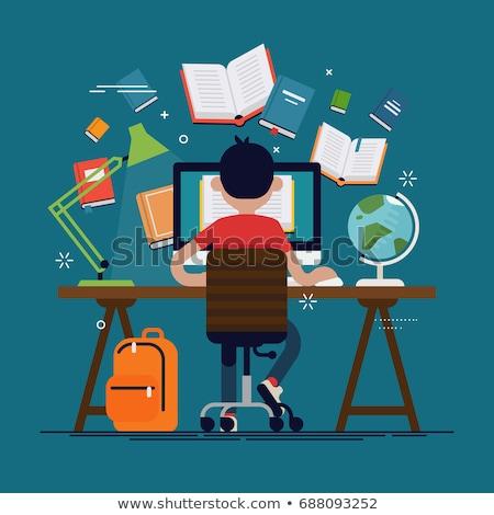 boy sitting at his school desk Stock photo © meinzahn