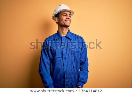 Young engineer looking away Stock photo © stockyimages
