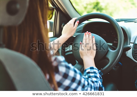Stock photo: Woman Hand Pressing On A Car Horn