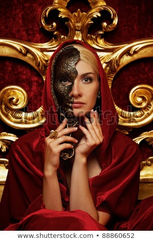 beautiful blond woman in a golden carnival mask stock photo © nejron