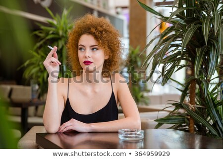 charming lady smoking cigarette stock photo © nejron