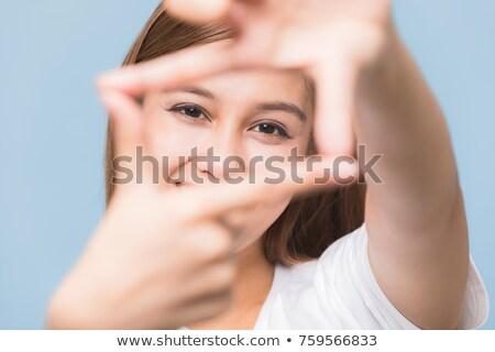 Jeunes asian femme cadre doigts Photo stock © bmonteny