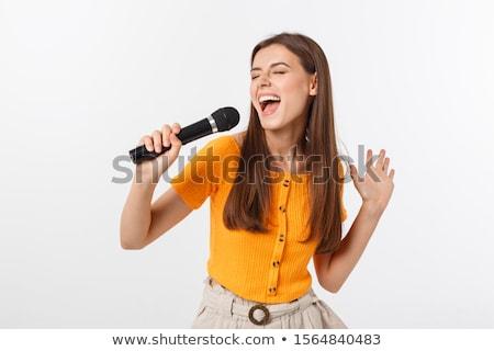 Gyönyörű nő élvezi zene énekel mikrofon fekete ruha Stock fotó © feelphotoart