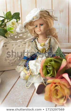 Elegant woman in Victorian style clothes and rose corset  Stock photo © Elisanth