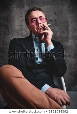 jovem · moda · homem · iluminação · cigarro · preto - foto stock © feedough