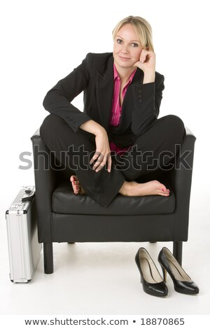 Young businesswoman sitting on a briefcase on white background studio stock photo © ambro