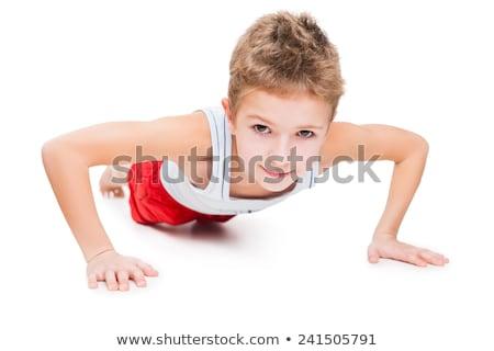 Stockfoto: Smiling Sport Child Boy Press Up Exercising