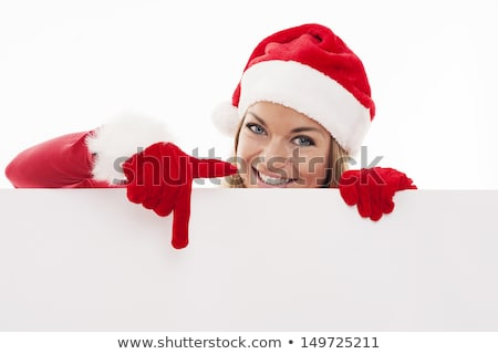 smiling woman in santa red hat pointing on blank space stock photo © nobilior