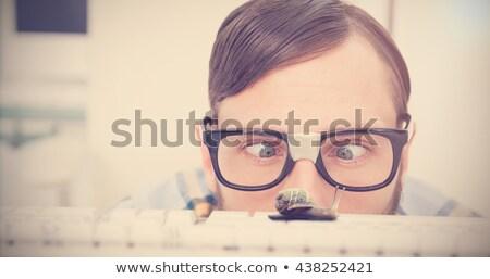 Puzzled nerdy businessman working on computer stock photo © wavebreak_media