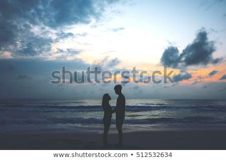 Mosolyog pár szemben egyéb tengerpart ünnepek Stock fotó © wavebreak_media