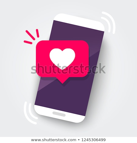 Hand hold the red heart out of a smart phone. Stock photo © teerawit