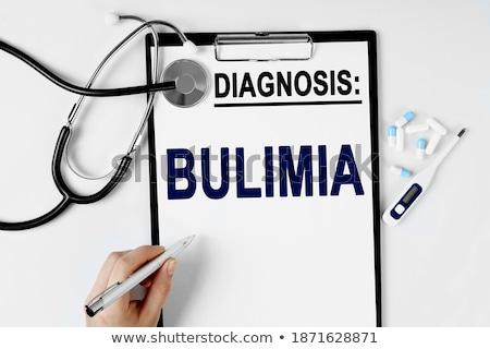 Diagnose boulimia medische Blauw pillen spuit Stockfoto © tashatuvango