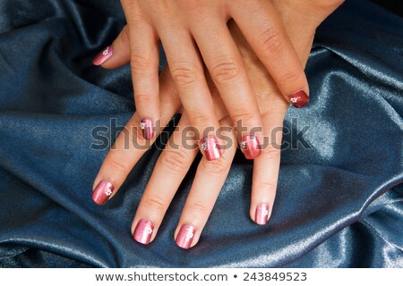 woman manicure arranged with blue satin stock photo © jordanrusev