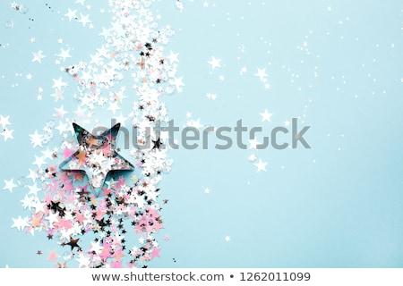 pink stars in the form of confetti on white stock photo © tetkoren